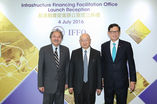 Mr John C Tsang [left] and Mr Norman TL Chan [right] officiate at the launch of the IFFO. Mr Chen Yuan attends as the guest of honour.