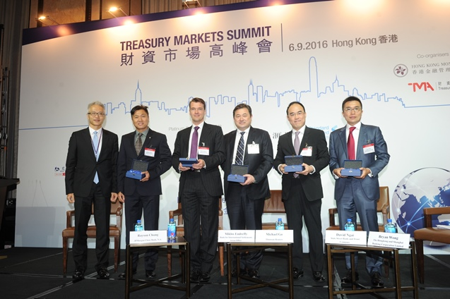 "Mr Howard Lee, Senior Executive Director of the HKMA and Chairman of the TMA Executive Board (first from left) presents souvenirs to speakers of the panel ""The new normal in treasury markets"".  The panel is moderated by Mr Rayson Chung, Managing Director, Head of Investments, Chief Investment Office, Asia Pacific of JPMorgan Chase Bank National Association (second from left).  The panellists are Mr Miklos Endreffy, Senior Portfolio Manager, Bank for International Settlements Asian Office (third from left); Mr Michael Go, Head of FX Market Development – Asia Pacific, Thomson Reuters (third from right); Mr David Ngai, Deputy APAC Head of Compliance and APAC Head of FX and Swap Dealer Compliance, Global Markets, State Street Bank and Trust Company (second from right); and Mr Bryan Wong, Managing Director, Head of Balance Sheet Management Hong Kong, Global Banking and Markets, The Hongkong and Shanghai Banking Corporation Limited (first from right)."