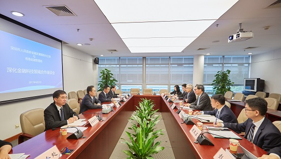 Chief Executive of the HKMA, Mr Norman Chan, and Director-General of the Office of Financial Development Service, the People's Government of Shenzhen Municipality, Mr He Xiaojun (second from left) agree to deepen bilateral cooperation in the area of Fintech.