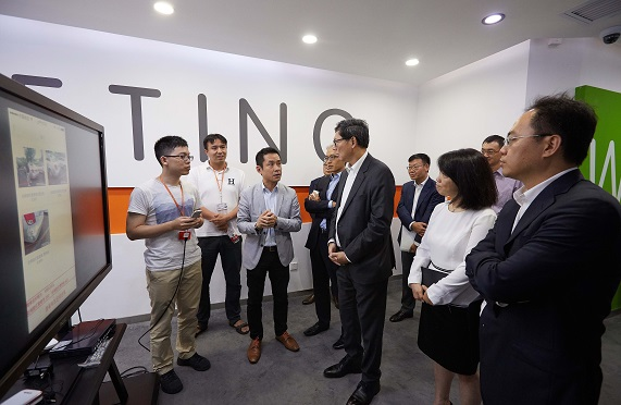 Mr Norman Chan and Mr He Xiaojun (first from right) visit Ping An Technology and meet with its Chief Executive Officer Mr Ericson Chan (third from left) to understand the research and development of innovative Fintech products.