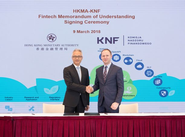 Mr Howard Lee(Left), Deputy Chief Executive of the HKMA and Mr Marek Chrzanowski, Chairman of the KNF sign and exchange the MoU in Hong Kong today (9 March 2018).