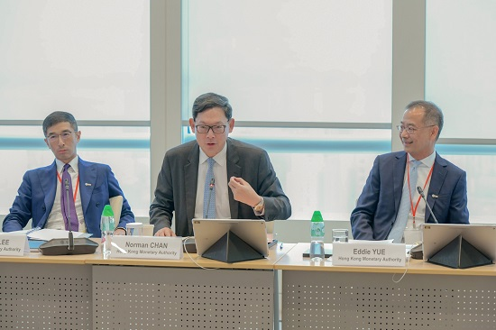 Mr Norman Chan, Chief Executive of the Hong Kong Monetary Authority, gives opening remarks at the Investors' and Debt Financing Roundtables.