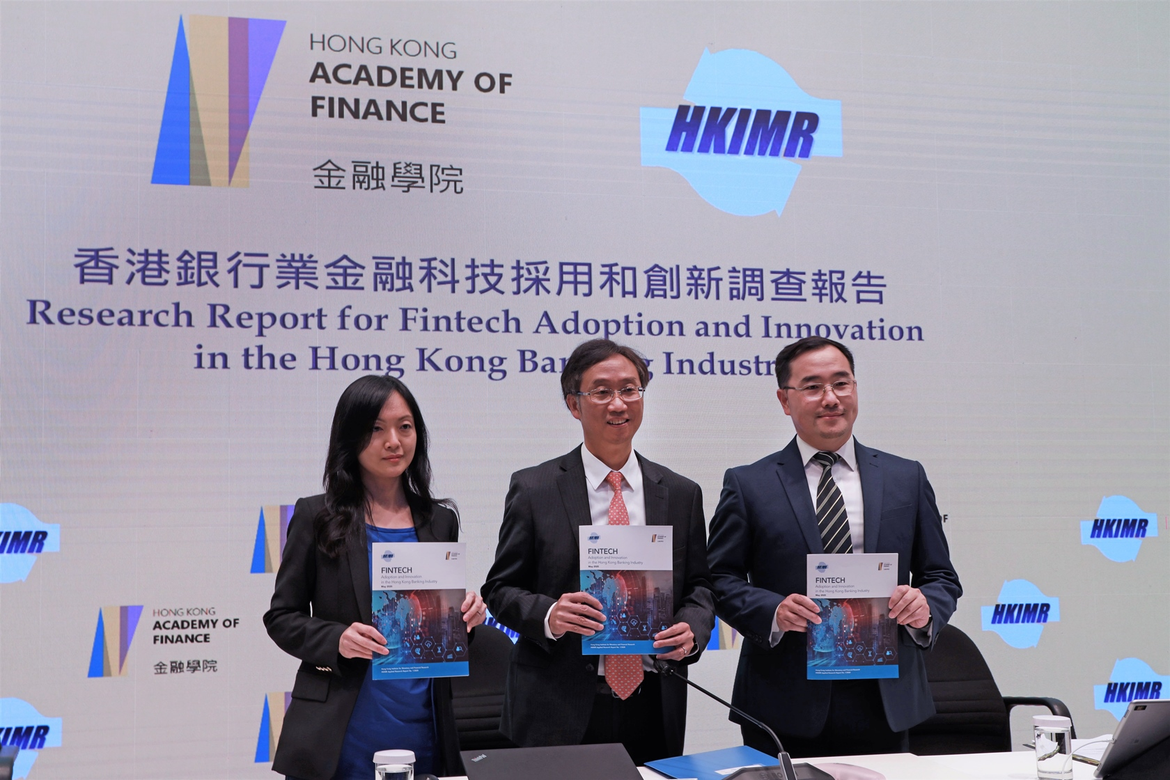 "The Hong Kong Institute for Monetary and Financial Research (HKIMR), the research arm and subsidiary of the Hong Kong Academy of Finance (AoF), publishes the first in a series of Applied Research reports, titled ""Fintech Adoption and Innovation in the Hong Kong Banking Industry"". Mr Edmond Lau, Senior Executive Director of the HKMA (centre), Ms Lillian Cheung, Executive Director (Research) (left) and Mr Colin Pou, Executive Director (Financial Infrastructure) (right), host a press conference to share the key findings of the report and the latest development of Fintech adoption in the Hong Kong banking industry."